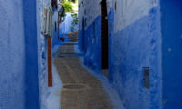 narrow alley in blue-washed walls in Chefchaouen in Rif Mountains Morocco