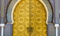 Door archway highlights traditional Moroccan handicrafts copper and zelige tile work Fes Morocco former imperial city