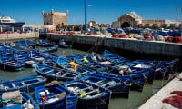 blue fishing boats in port of Essaouira Morocco formerly Mogador fresh seafood for lunch